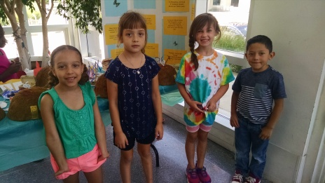 Campers pose in front of their artwork during Session C